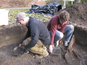 CAP workers/interns excavate on campus