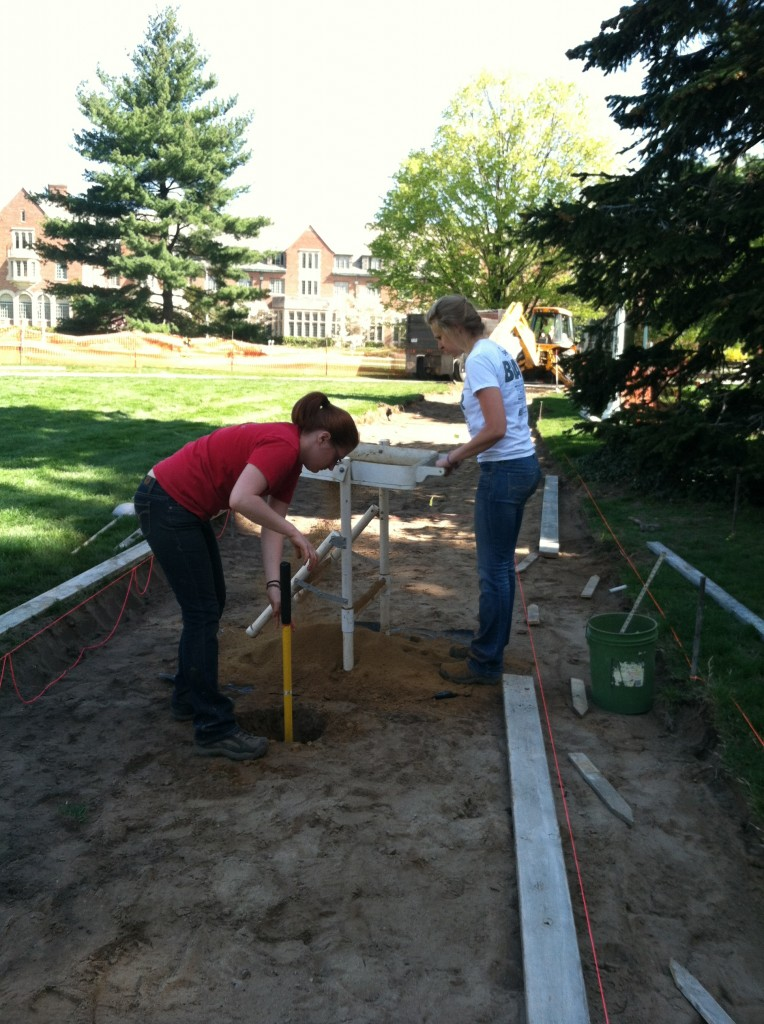 Bethany and Katie shovel testing at Adams Field