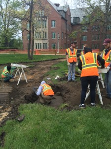 CAP crew works excavating the sidewalk feature