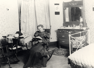 Female student in dorm room 1896 - oil lamp can been seen on her dresser. Image courtesy of MSU Archives & Historical Collections