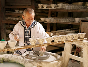 Making porcelain vessels in modern Jingdezhen, China. Image Source