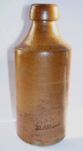 An example of a plain, early stoneware ginger beer bottle. From diggersdiary.co.uk.