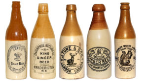 Examples of later, more decorative stone ginger beer bottles